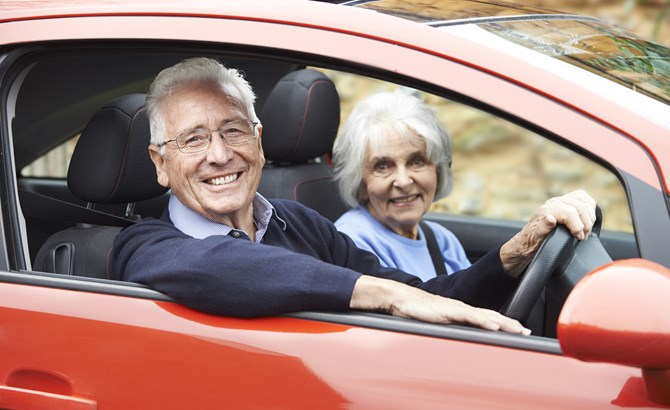 Over 70s couple in red car