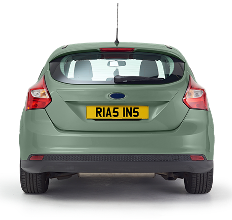 The back of a mint green coloured car with a personalised Rias plate