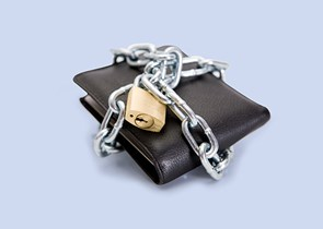 A wallet with a chain and lock around it on a blue background