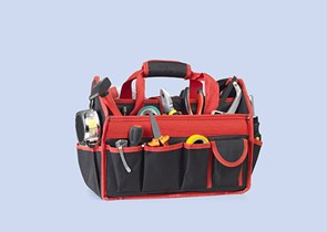 A red tool kit bag on a blue background