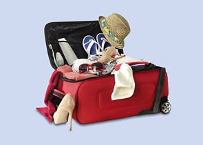 An open red suitcase with personal belongings inside on a blue background