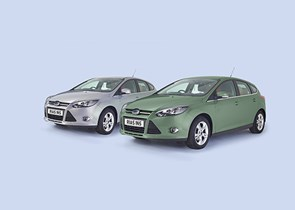 Grey and mint green cars side by side on a blue background
