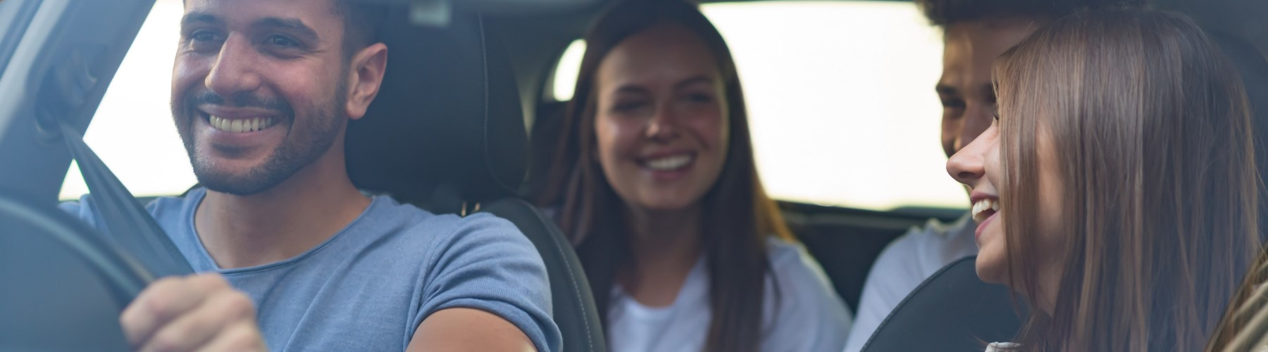Car filled with friends laughing