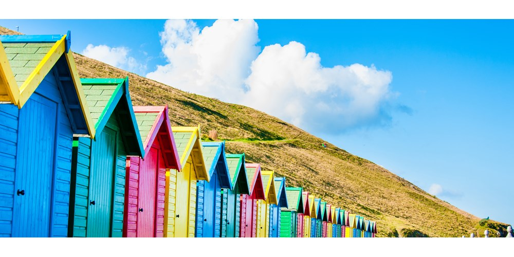 A row of multicoloured beach huts