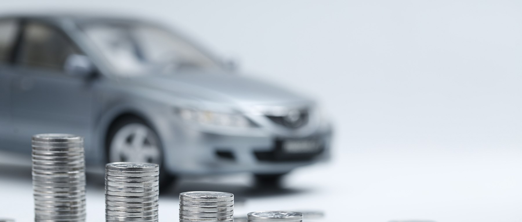 Silver car and coins