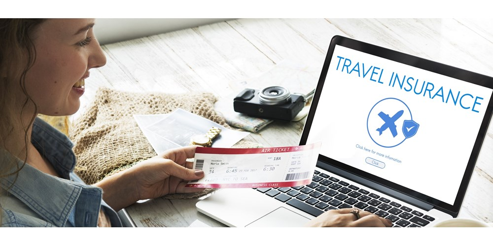 Young woman buying travel insurance online