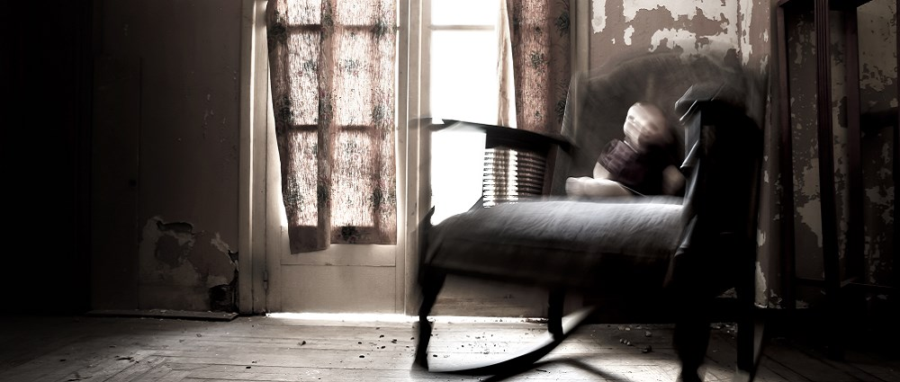 Haunted house with doll on rocking chair