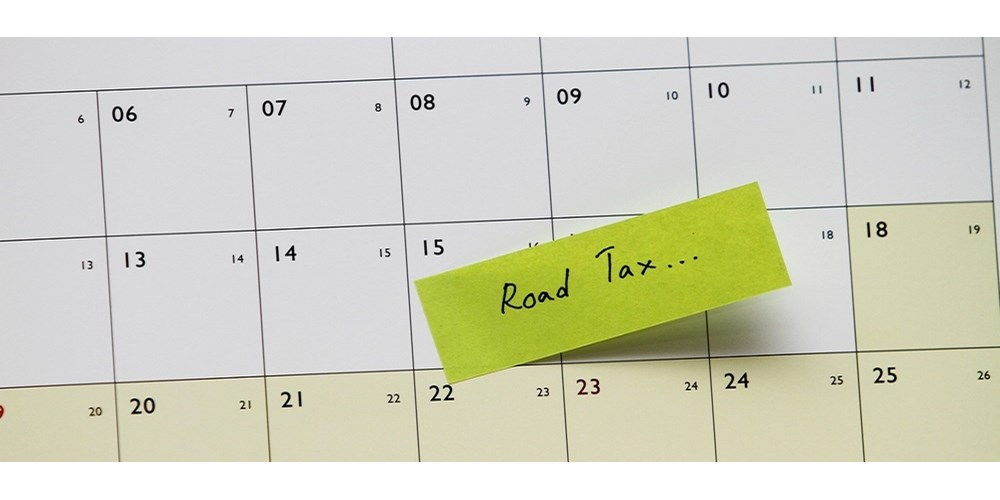 "A calendar with a post it note saying ""road tax"""