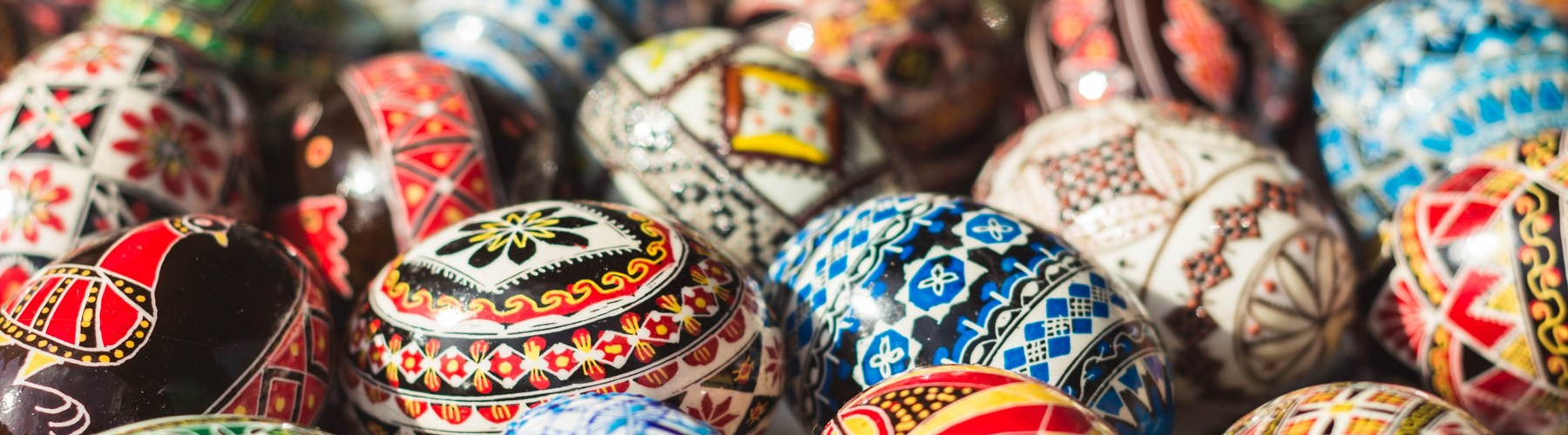 Multi-coloured hand-painted rustic Easter eggs