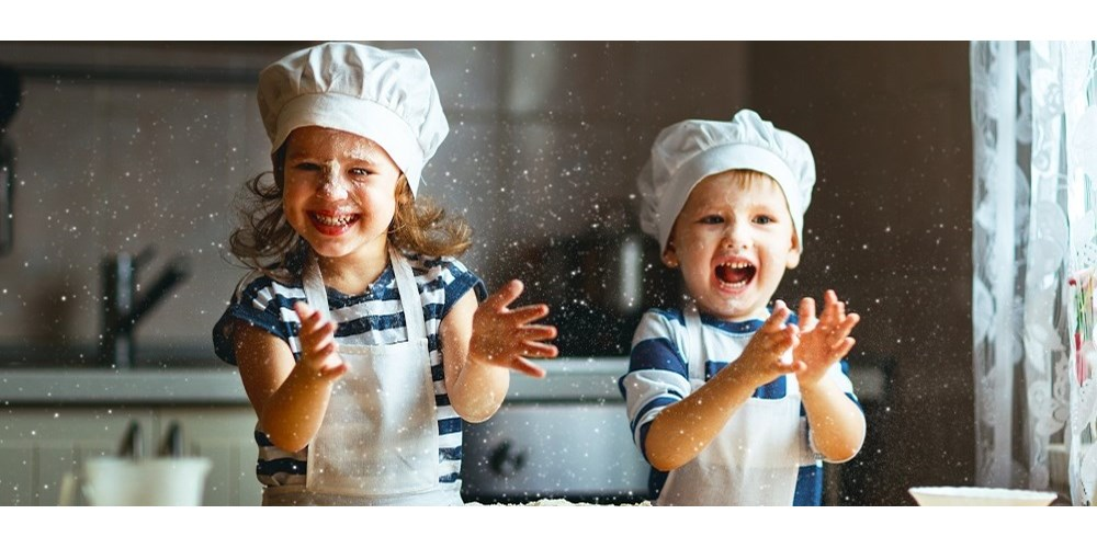 Happy kids having fun baking