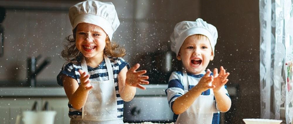Happy kids having fun baking