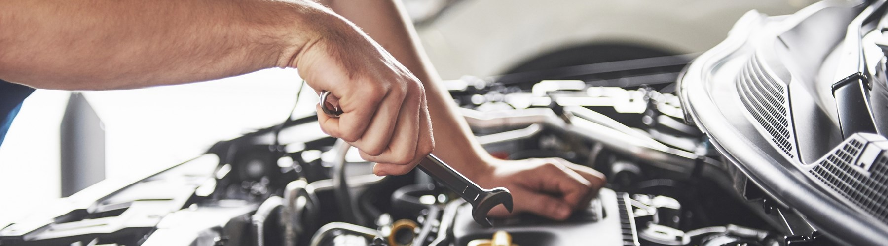 Man checking his car engine