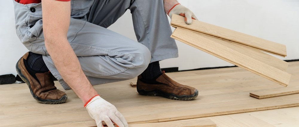 Man fixing floorboards