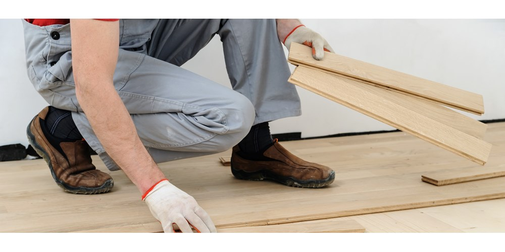 Man fixing floorboards