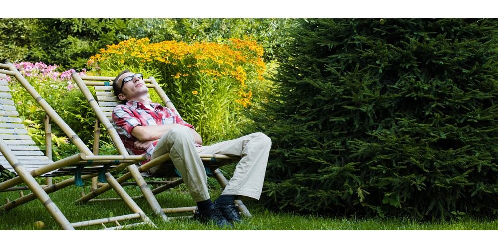 Man lounging in garden deckchair