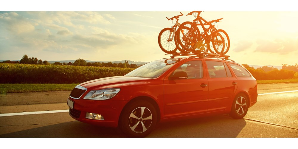 Red car carrying bicycles