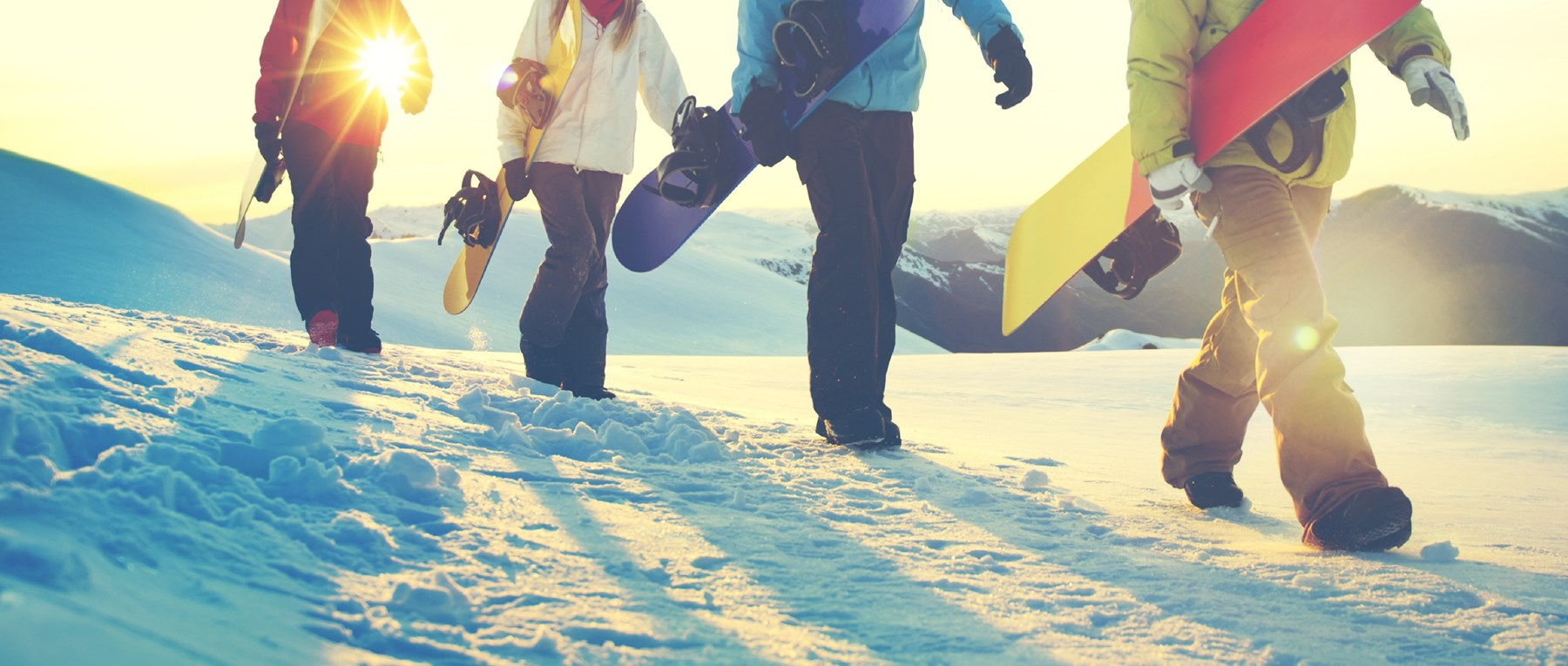 Snowboarders walking in the snow