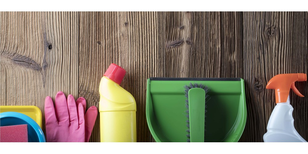 Household cleaning items on wooden flooring