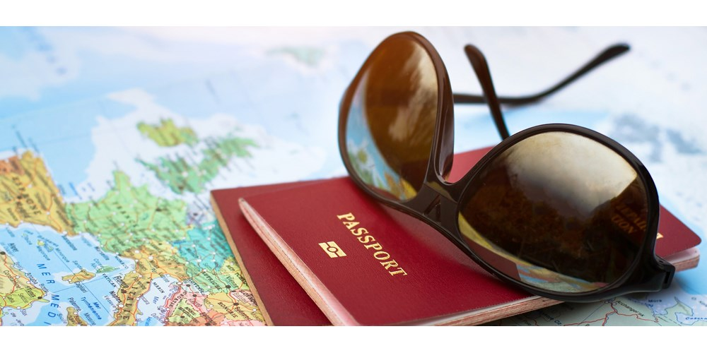 Sunglasses and passport on map
