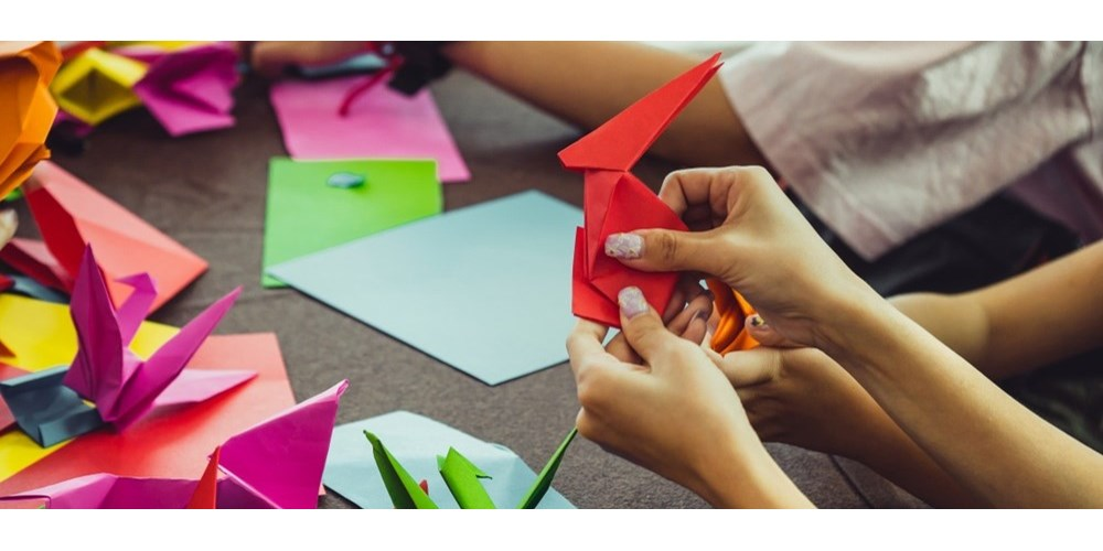 Woman's hands doing origami