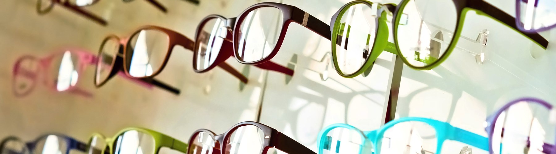 Variety of coloured glasses in opticians