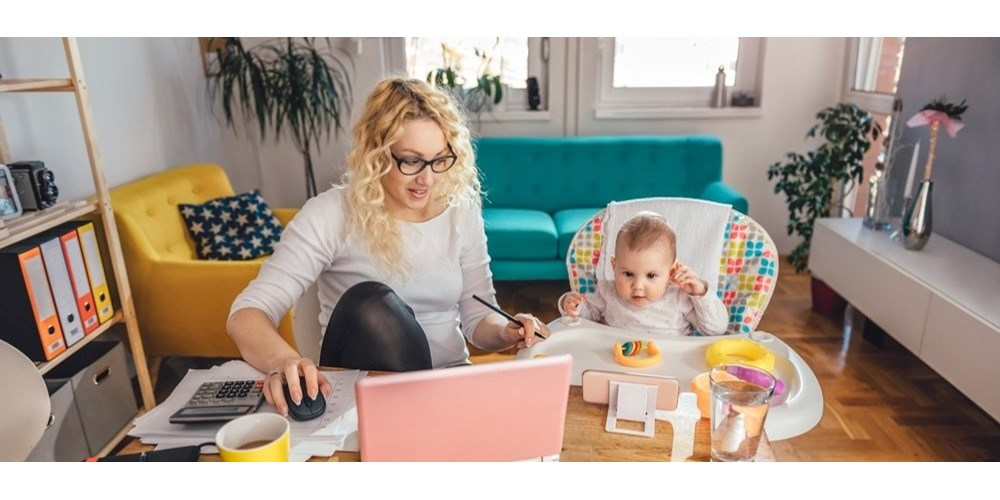 Mum working from home with baby