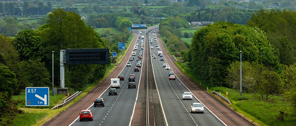 Cars driving along a motorway