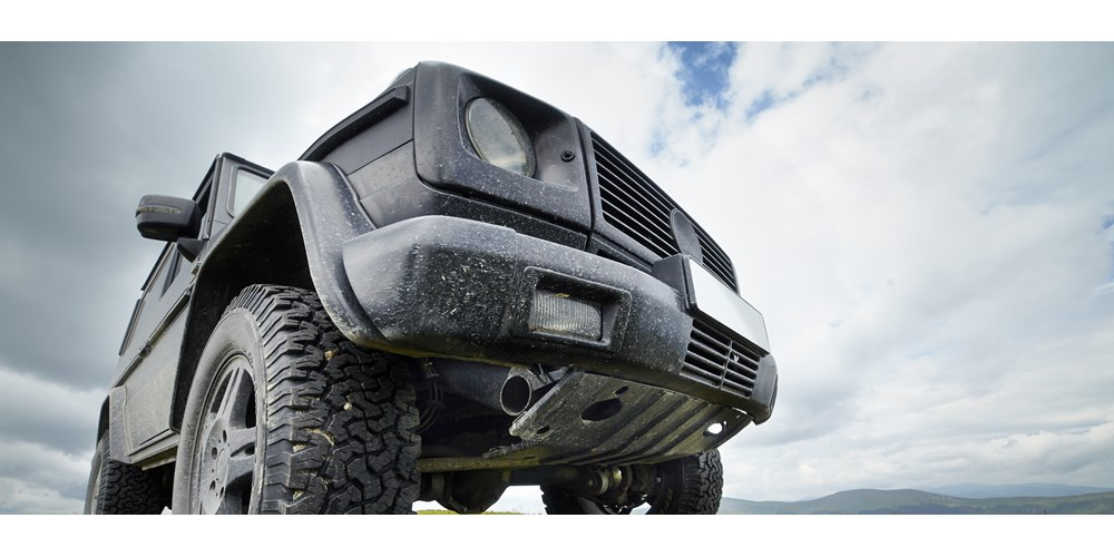 Close up image of black 4x4 car