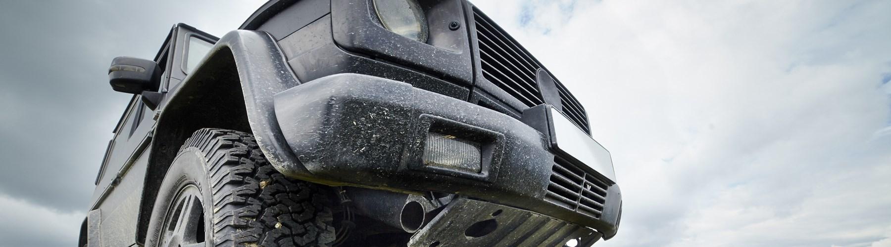 Close up image of black 4x4 car