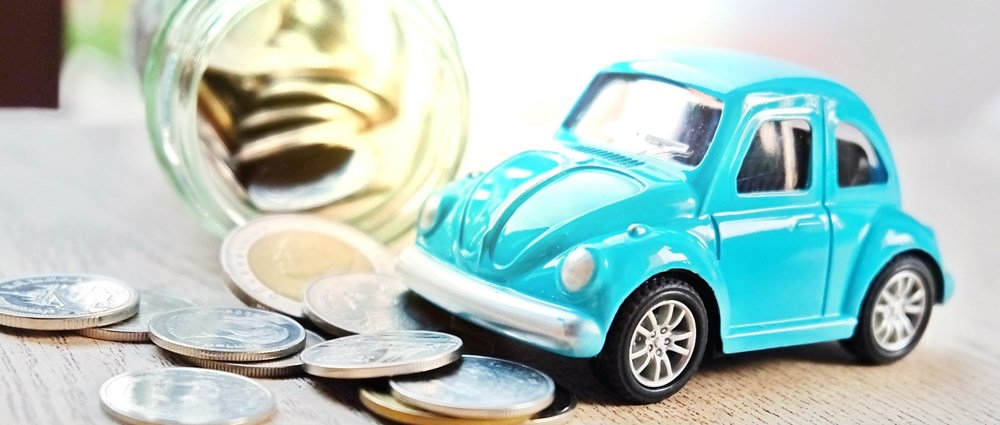 Blue toy car and coin jar