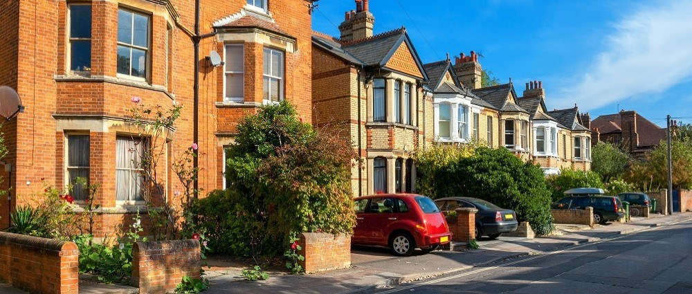 British houses with parked cars in driveway