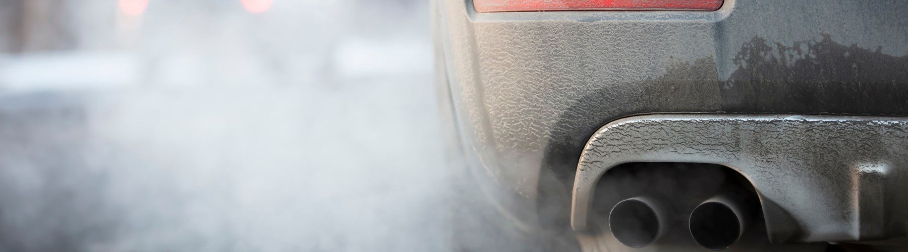 A car idling pumping out fuel