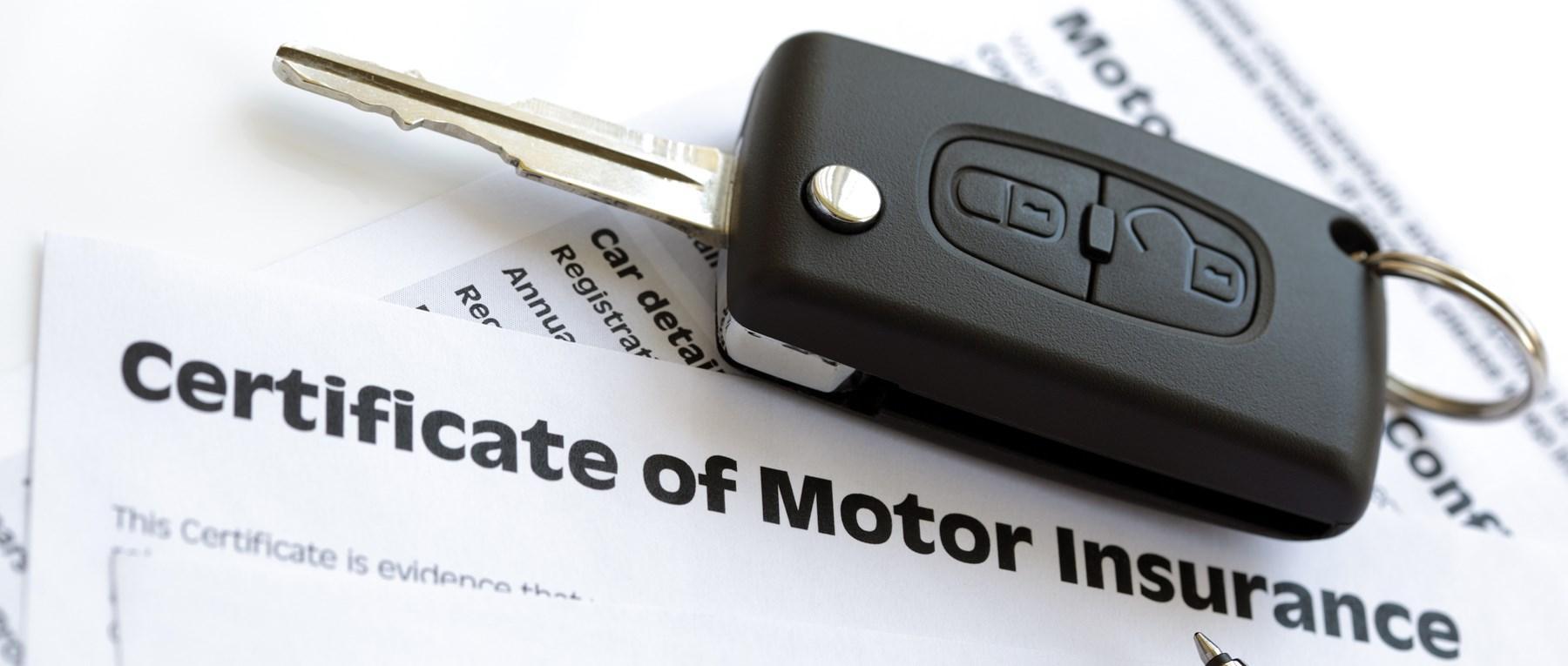 Car keys over certificate of motor insurance