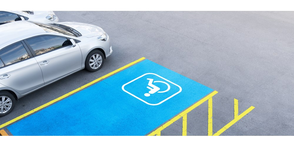 Blue and yellow disabled parking space