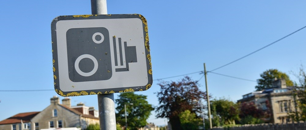 A speed camera road sign