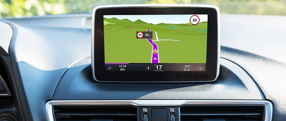 A driverless car with a sat nav on the dashboard