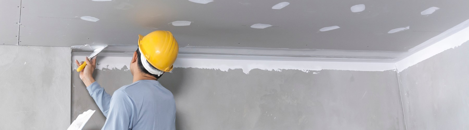 Builder plastering a wall
