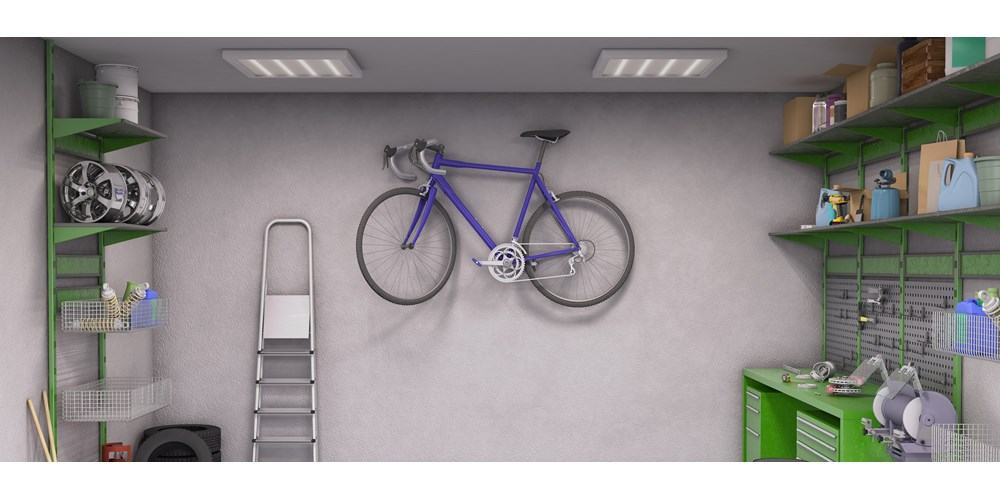 Purple bicycle hanging on the wall in garage