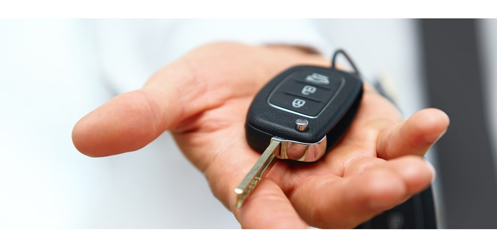 Hand holding an electric car key