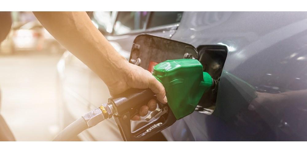 Man fuelling grey car