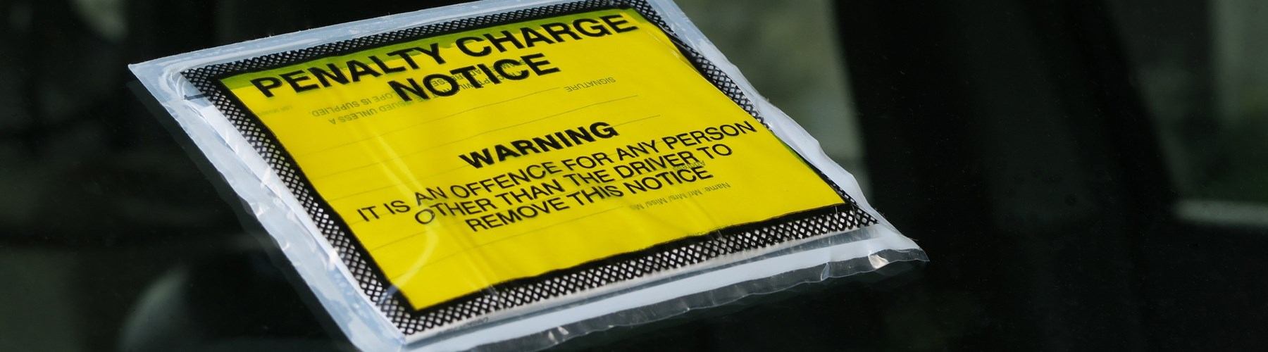 Penalty charge notice on car windshield