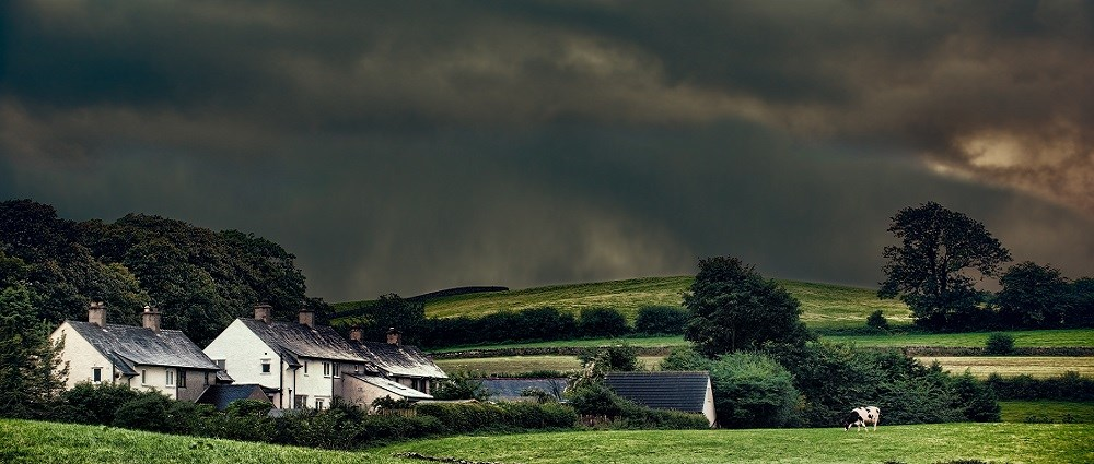 A stormy sky above houses