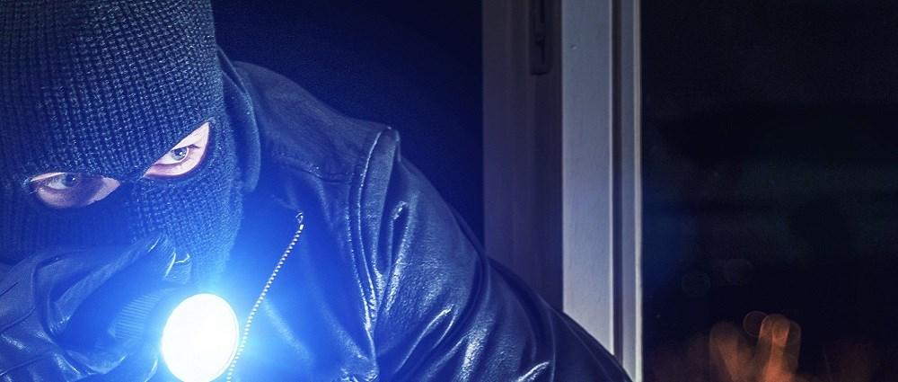 A burglar shining a torch